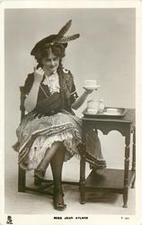 MISS JEAN AYLWIN  Scottish attire, seated taking tea