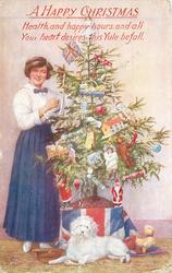 A HAPPY CHRISTMAS  (woman in blue skirt next to tree, white dog in front)