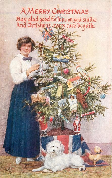 A MERRY CHRISTMAS  (woman in blue skirt stands next to tree, white dog in front)