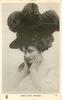 MISS KITTY GORDON  hands to face, very large ostrich feathered hat
