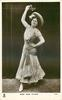 MISS JEAN AYLWIN  facing front holding flower above her head
