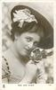 MISS JEAN AYLWIN  head & shoulders, faces right, looking front, holding rose to nose