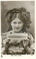 MISS JEAN AYLWIN  holding box of CLARO cigars