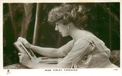 MISS VIOLET VANBRUGH  sitting reading, facing left
