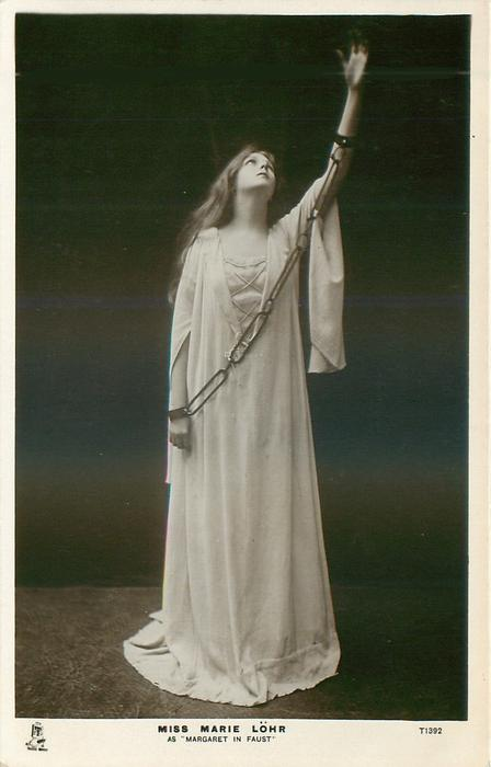 MISS MARIE LOHR AS 'MARGARET IN FAUST'  standing chained with left arm raised
