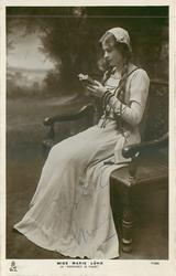 """MISS MARIE LOHR AS """"MARGARET IN FAUST""""  sitting reading"""