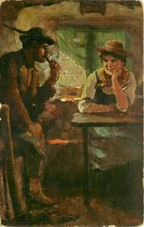 man sits smoking pipe holding foot up with his right hand, maid sits at table chin in hand