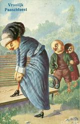 two chick urchins observe lady chick in blue dress adjust clothing, one foot up on a seat