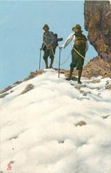 two  roped climbers, snow front, sky behind