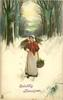 young woman, red top & white skirt carries faggot on shoulder & basket, walks front in snow, her right hand on hip