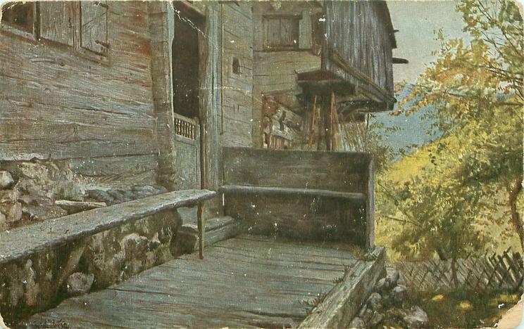 dark wooden building close left, bushes right