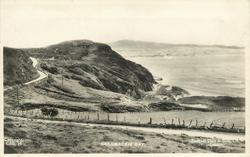 COLDBACKIE BAY  from land looking out over the bay, road & headland left