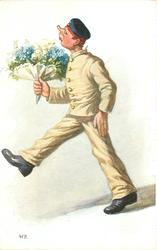 soldier in ill-fitting white uniform strides left holding large bouquet of blue forget-me-nots & white lilies-of-the valley