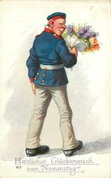 soldier in ill-fitting uniform holds large bouquet, he faces away but looks back over his shoulder