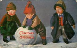 three boy-dolls and large snowball