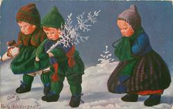 three doll-children walking left, one carrying frosty Xmas tree