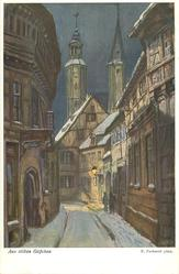 winter alley, houses on both sides lighted shop at end, two couples standing