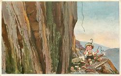 unhappy boy has fallen on mountain side, he holds end of broken rope, his gear strewn all around