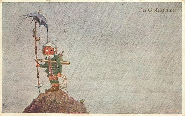 unhappy boy carrying telescope & rope stands on mountain top under umbrella tied on his staff