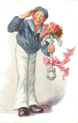 sailor in white trousers, blue top, stands saluting, carrying fake anchor with pink bow & flowers on top