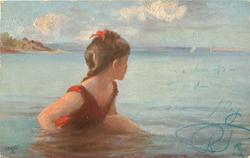 girls in red bathing suite  sits in water looking out to sea