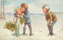 boy holding mistletoe kisses girl on her cheek, another boy right with hands on knees observes with glee