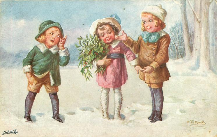 girl holding mistletoe stands between two boys in snow