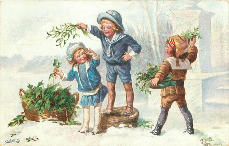 boy stands on basket holding mistletoe over girl, another right carries holly, basket of holly on ground left