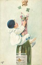 boy in white harlequin suit holds tight watching champagne escaping from opening champagne bottle