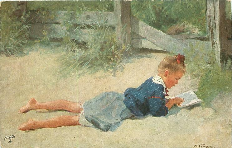 girl reads book lying prone prone facing right