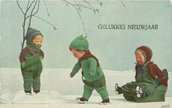 3 doll-children, one stands left under tree observing another pull sister on sled, snow scene