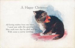 A HAPPY CHRISTMAS  kitten with orange bow