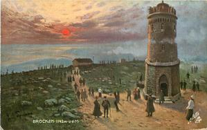 BROCKEN-1142M.U.D.M. evening scene, sun back left, many people going up path away from monument & on horizon