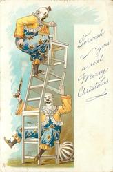 TO WISH YOU A REAL MERRY CHRISTMAS  two clowns in blue and yellow balancing chairs