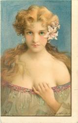 young lady with low cut light green dress, long hair tied behind neck, lilies over left ear & earings