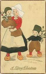 A MERRY CHRISTMAS  Dutch mother carries child, another holds to her skirt, both carry holly