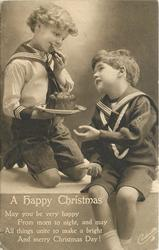 A HAPPY CHRISTMAS  (boy in light sailor suit eats cake)