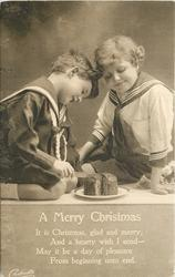 A MERRY CHRISTMAS  (two boys in sailor suits, one cuts cake)