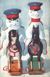 two snowman dressed as German soldiers, each on a wooden horse on wheels