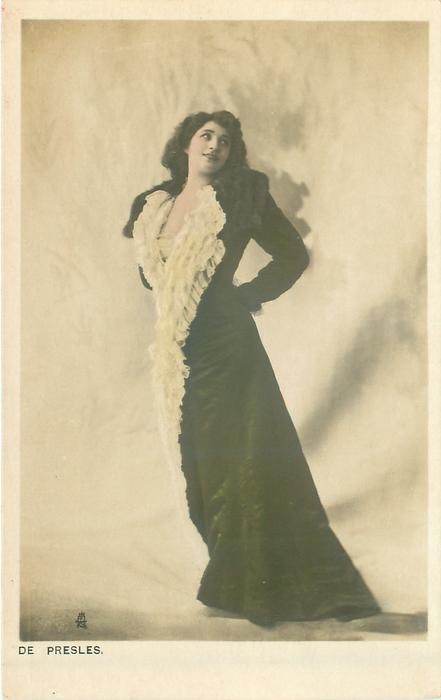 DE PRESLES  dark dress, lace fringes down front, faces left looking up to right