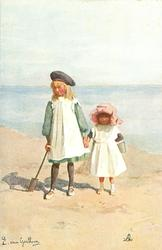 ON THE SANDS  two girls stand hand in hand on sandy beach with bucket & spade