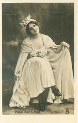MISS EDNA MAY  seated with legs crossed, holding robe widely spread