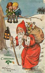 """IS HE GOING OUR WAY?""  Santa with bag of toys on back and lantern, boy and girl sit on tree and watch"