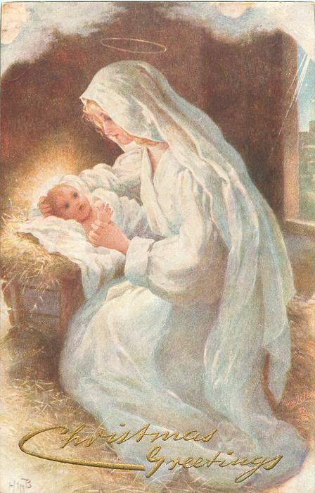 Mary leans over Baby Jesus in manger
