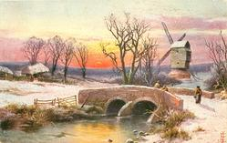 brick built bridge with 3 people standing on it, windmill behind right, sunset