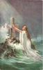 woman kneeling in sea before cross, light beaming down  from above