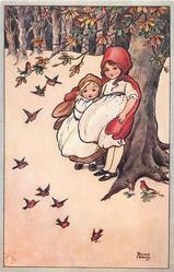 two children stand in front of tree trunk, many robins flying down