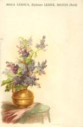 purple lilac in copper jug on table
