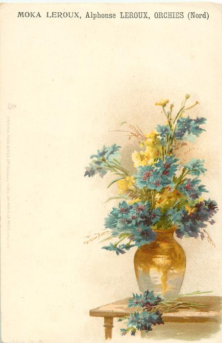 blue cornflowers & yellow flowers in glass vase on table