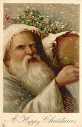 A HAPPY CHRISTMAS  head and shoulders of white robed Santa carrying yule log, facing partly right